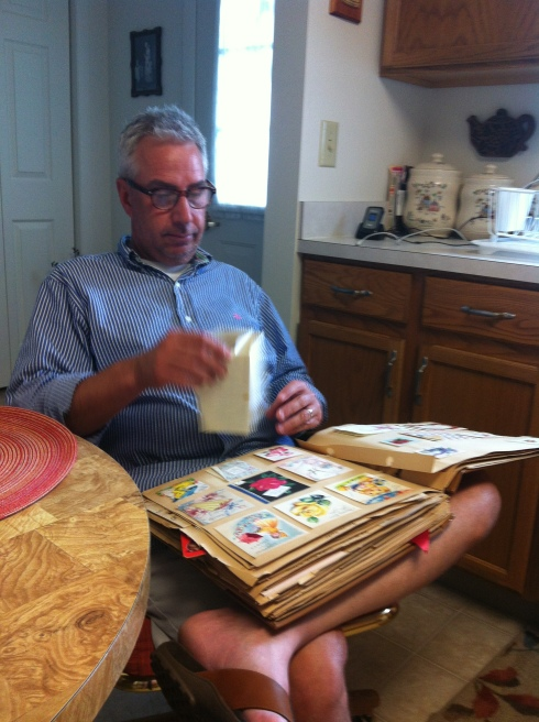 The Mister checks out scrapbooks with me